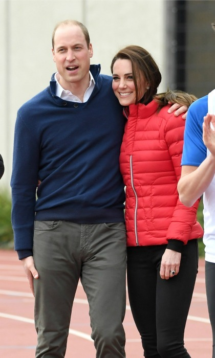 Prince William held on to Kate (and his own leg!) after he beat her and his brother Harry a relay race during the Team Heads Together training day in London in February 2017. 