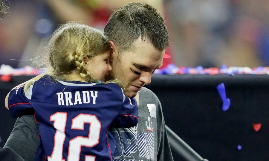Brady's little lady! Tom Brady's daughter Vivian held on to her Super Bowl winning father after Super Bowl LI in Houston. 