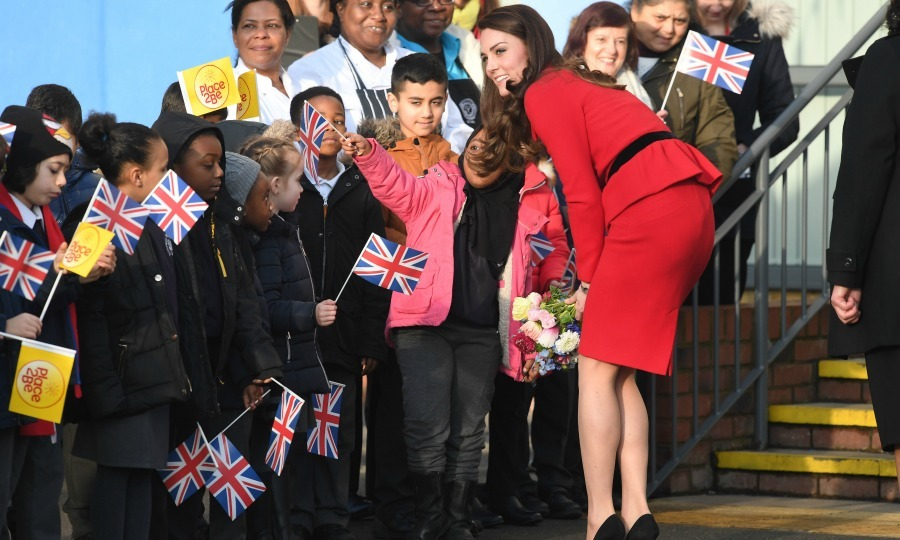 Kate-a-pa-looza! The Duchess was greeted by a long line of kids holding up signs in support of Children's Mental Health week at the Place2Be Big Assembly with Heads Together in London. 