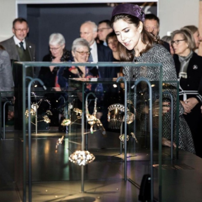 "Crown Princess Mary attended the official ""Jewel Box"" exhibit which showcased a range of 20th century Danish jewelry from combs, brooches, bracelets, rings, necklaces, cufflinks and shoe buckles. 