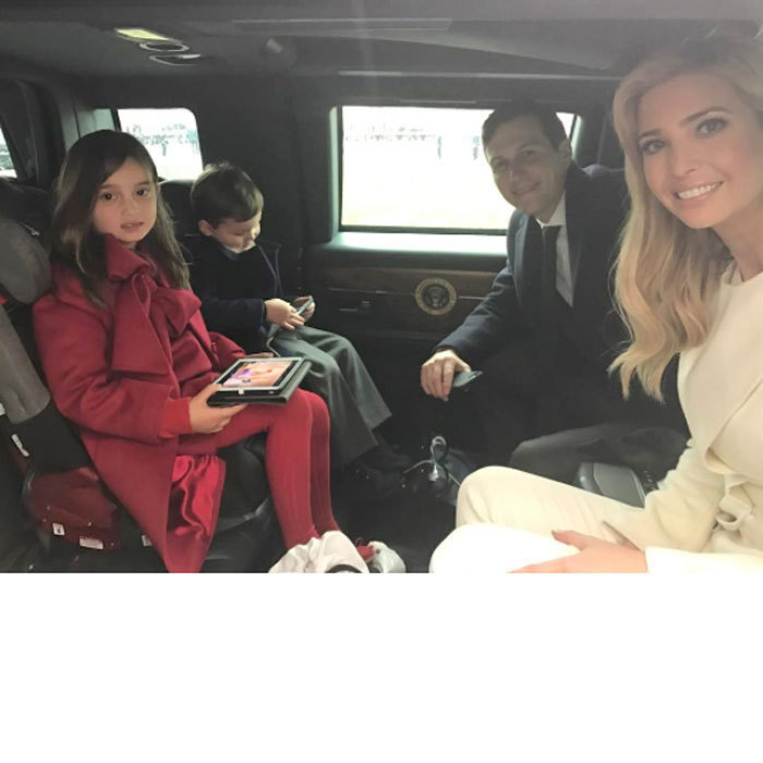 Arabella and Joseph kept themselves entertained playing with an iPad and electronics as they made their way to their grandfather President Donald Trump's inauguration parade in a limo.