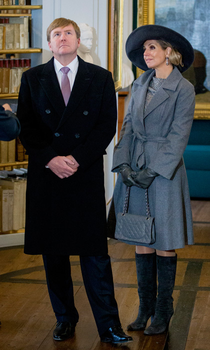 Queen Maxima looked <i>fifty shades of grey</i> and chic accessorizing with suede boots, Chanel bag and wide-brimmed hat as she appeared alongside husband King Willem-Alexander at the Hertogin Anna Amalia Bibliotheek in Erfurt, Germany. 