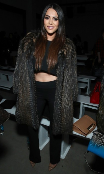Andi Dorfman showed off her abs in a black crop top and matching pants at the Nicole Miller show. The former <i>Bachelorette</i> star stayed snug in an exquisite fur coat that accented her lengthy ombre locks.