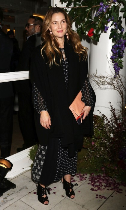 Drew Barrymore looked chic at the Club Monaco show, naturally posing next to flowers. The actress took to Instagram to thank Club Monaco for having her and her cosmetics line, Flower Beauty: