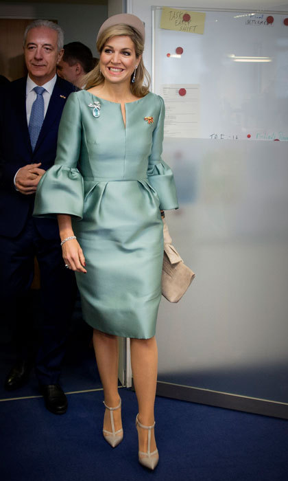 Queen Maxima was a vision in a sea foam green dress with trumpet sleeves, which she wore for her visit to the European Energy Exchange in Leipzig, Germany. 