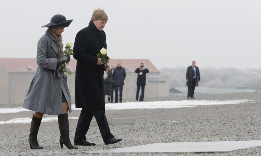 The King and Queen carried white roses as they visited the Buchenwald concentration camp in Weimar, Germany. The mother-of-three looked somber, dressed in an understated ensemble and wide-brimmed black hat for the occasion.