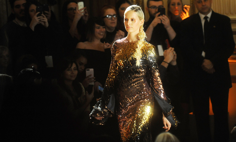 Karolina Kurkoval dazzled on the runway modeling a sequin dress at the Christian Siriano show held at the Plaza Hotel. Prior to the runway, the model got prepped with Essie nail polish.