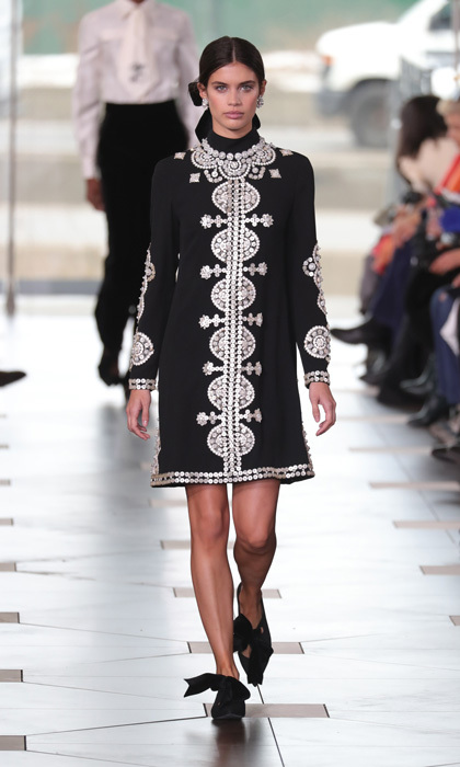 Victoria's Secret Angel Sara Sampaio walked the runway at the Tory Burch show modeling a black and white embellished dress.