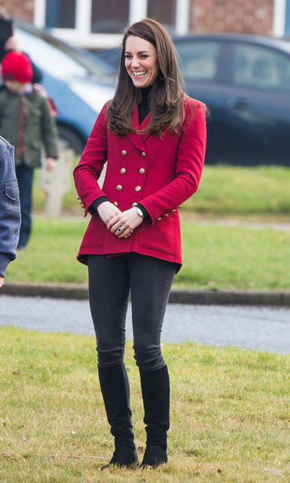 Kate Middleton was Valentine's Day ready wearing a red double-breasted twill blazer by Philosphy Di Lorenzo Serafini, which she paired with a black turtleneck and jeans, for her visit with the RAF Air Cadets at RAF Wittering in Stamford, England.