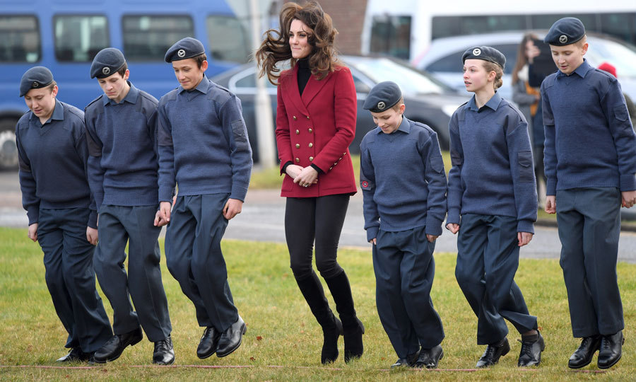 The Duchess of Cambridge let her hair fly as she played jumping games with young cadets during her visit to a RAF base in Cambridgeshire. 