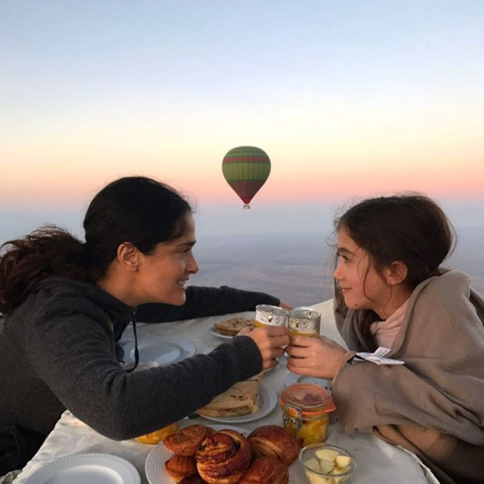 "Salma Hayek spent the day with her ""little valentine,"" daughter Valentina. The doting mom shared a picture of their scenic date, writing, ""With my little valentine floating in the air at #sunrise in a #hotairballoon #happyvalentinesday #nofilter. Celebrándolo el santo de Valentina en un globo al #amanecer. Feliz día del amor y de la amistad.""