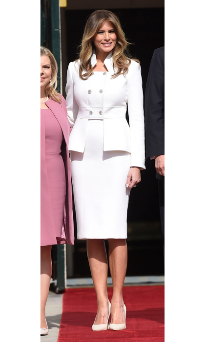 The first lady was a vision in white stepping out in a custom ensemble by Karl Lagerfeld to welcome Israeli Prime Minister Benjamin Netanyahu and his wife, Sara, to the White House on February 15, marking her first official appearance at the presidential residence since her husband's inauguration. Melania wore a cashmere pencil skirt and matching peplum double breasted jacket that featured a military-style collar for the occasion.