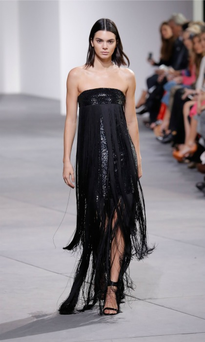 Kendall Jenner was in the zone as she walked the runway in a fringe number at the Michael Kors show. 