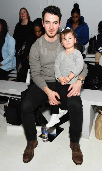Kevin Jonas' daughter Alena made her very first appearance at fashion week, sitting on her daddy's lap during the Rookie USA fashion show. 