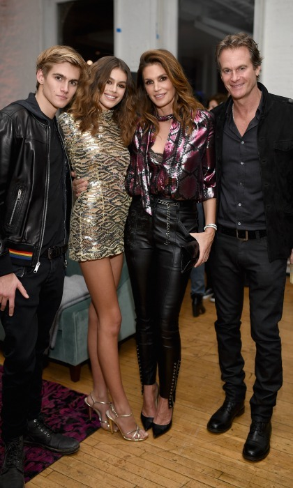 All in the family! Kaia Gerber posed with her brother Presley and parents Cindy Crawford and Rande Gerber during the Marc Jacobs Beauty celebration in her honor. 
