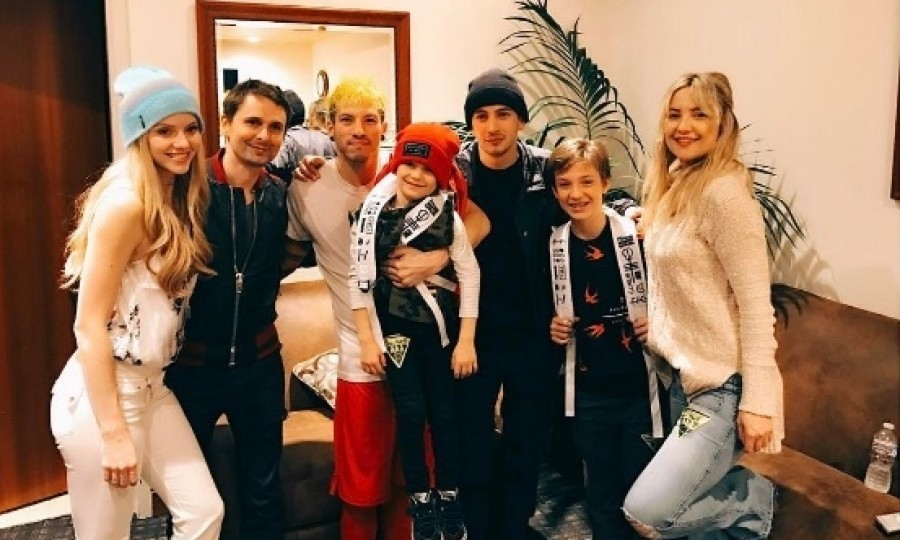 """Kate Hudson and her ex Matt Bellamy surprised their son Bingham and his brother Ryder with the show of a lifetime. The actress posted a photo of her, the boys and Matt smiling around the band, Twenty One Pilots. """"Surprised the boys tonight with their favorite band @twentyonepilots. Thank you guys and the whole TOP family for making it so special. We had a blast."""" Photo: Instagram/@katehudson"""