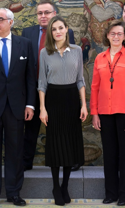 Queen Letizia wore a black pleated skirt by BOSS for her engagement to meet with representatives from the Vianorte-Laguna Foundation at Zarzuela Palace. 