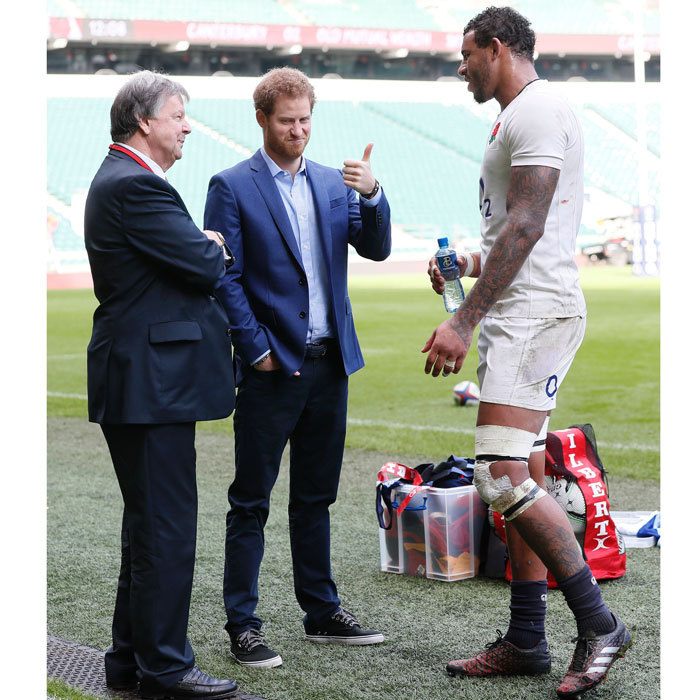 Prince Harry gave a thumbs up while chatting with England player Courtney Lawes and Ian Richie, CEO of the RFU, during a visit to an England Rugby squad training session at Twickenham Stadium.