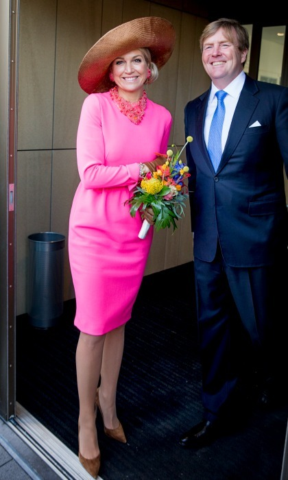 Queen Maxima was pretty in pink (with the perfect topper) as she stood next to King Willem-Alexander during a visit to the town hall in Krimpen. 