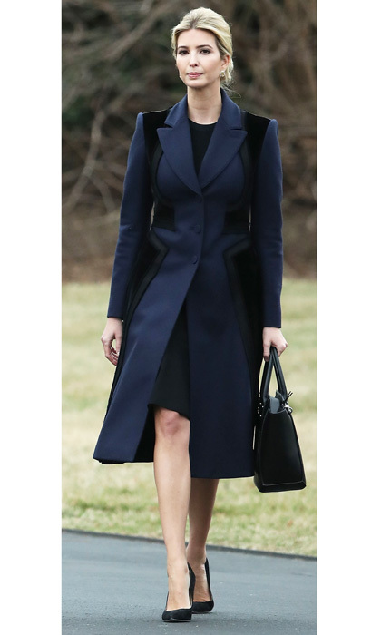 The mom-of-three donned a sophisticated, navy and black panel coat by Altuzarra for a trip to Delaware with her father to pay their respects to Chief Special Warfare Operator William 'Ryan' Owens, who was killed during a raid in Yemen.