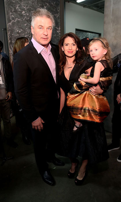 Alec Baldwin, Hilaria Thomas Baldwin and Carmen Baldwin made a fashionable trio backstage at Carmen Marc Valvo during New York Fashion Week.