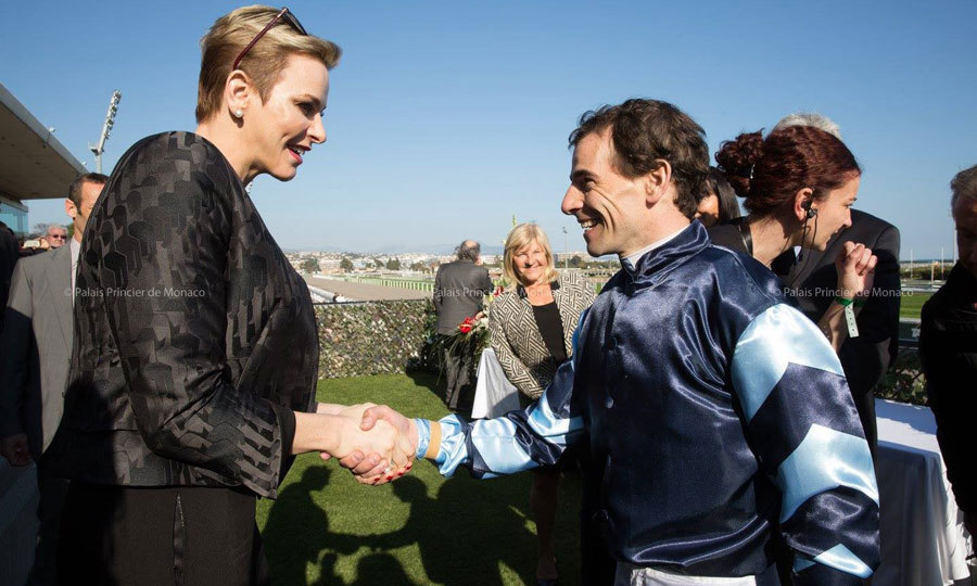 Charlene congratulated jockey Ronan Thomas who won in the Prix Princesse Charlène de Monaco Charity Mile. The Monaco royal looked chic for her outing to the racecourse wearing a black jacket and matching trousers.