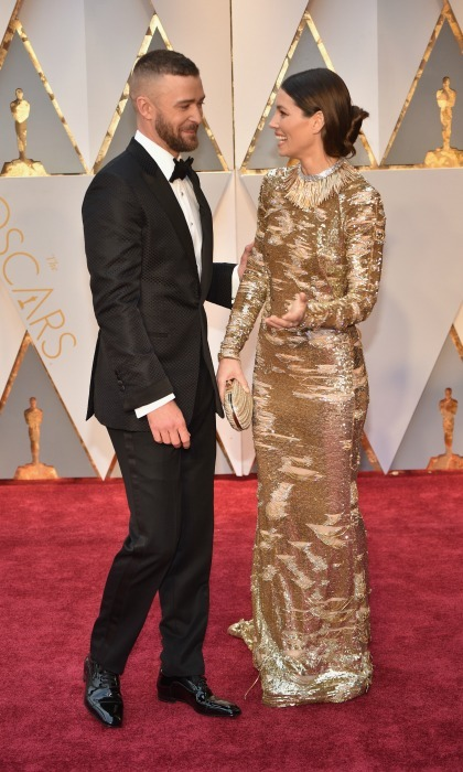 "Justin admired his wife's gold KAUFMANFRANCO gown throughout the evening of the Academy Awards, telling E! News ""I call it perfection.""