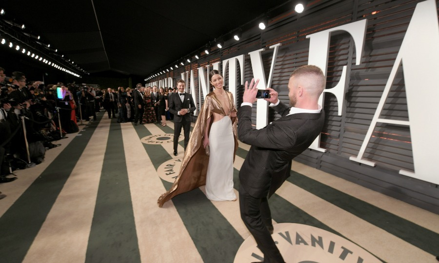 Justin proved that no matter what Jessica wore, he loved it. The <i>Can't Stop the Feeling</i> singer snapped pictures of his leading lady, who changed into a caped dress by Ralph Lauren, while on the Vanity Fair Oscars party red carpet. 