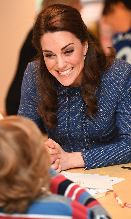 The Duchess of Cambridge couldn't help but grin as she chatted with an adorable new friend at the opening of the Ronald McDonald House Evelina London.