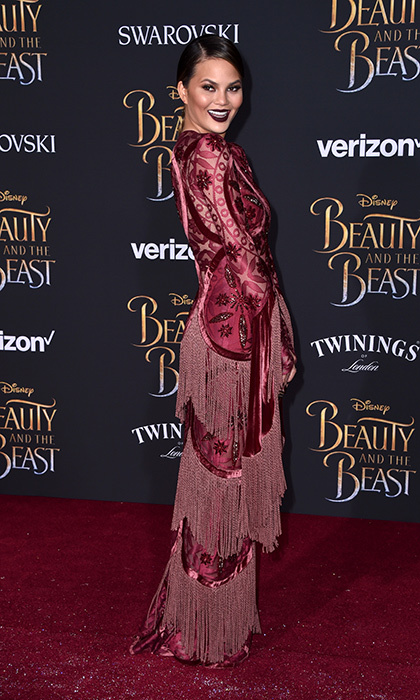 March 2: Chrissy Teigen enjoyed some fringe benefits at Disney's <i>Beauty and the Beast</i> premiere at El Capitan Theatre in Los Angeles.
