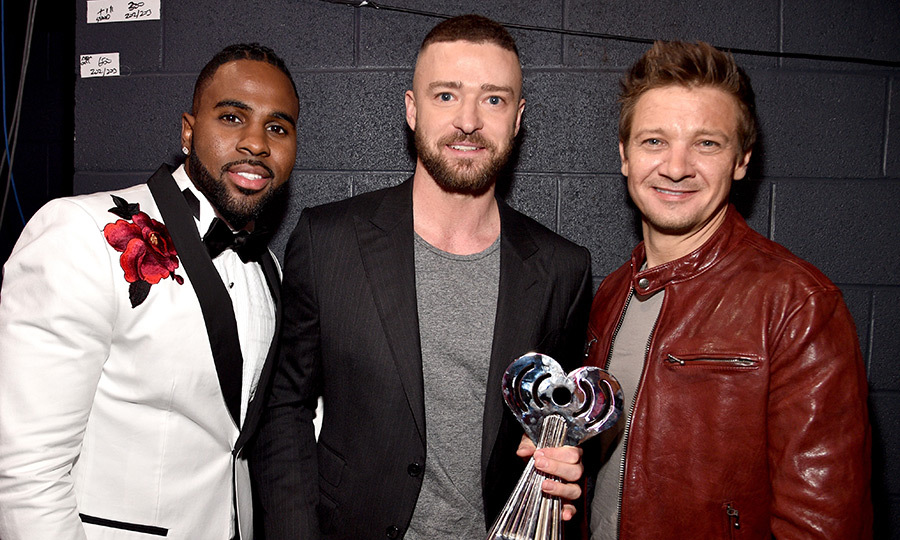 March 5: Jason Derulo, left, and actor Jeremy Renner, right, congratulated Justin Timberlake, who won Song of the Year for <I>Can't Stop The Feeling</I>  at the 2017 iHeartRadio Music Awards in Inglewood, California