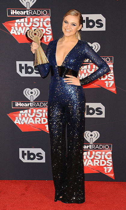 Kelsea Ballerini showed off her sparkling jumpsuit – and her Best New Country Artist trophy! – at the 2017 iHeartRadio Music Awards at The Forum in Inglewood, California. 