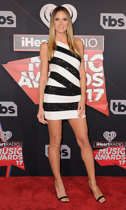 March 5: Heidi Klum was looking leggy in a black and white striped mini at the 2017 iHeartRadio Music Awards. 
