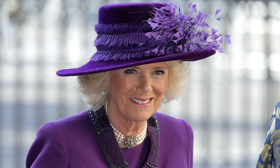 Camilla, Duchess of Cornwall, wore all purple and her trademark pearl choker for the Commonwealth Day Service at Westminster Abbey in central London.