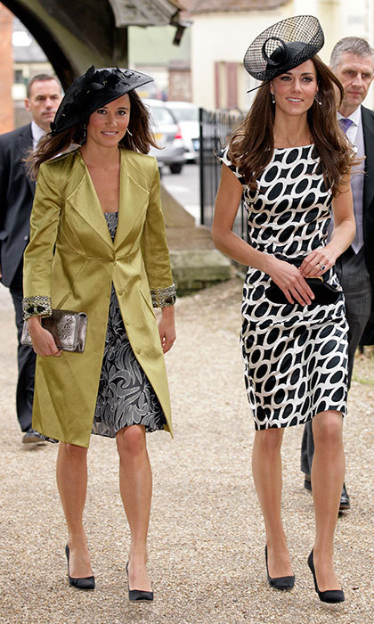 Kate and Pippa Middleton were in step as they attended a wedding at St Michael and All Angels church on June 11, 2011 in Lambourn, England. 
