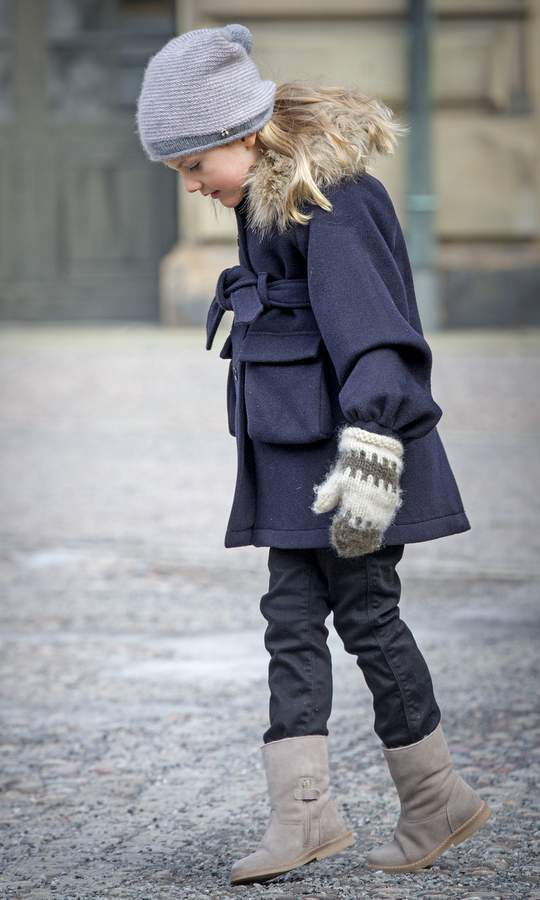Princess Estelle of Sweden sported this cute mittens and hat combo with a pretty blue jacket to celebrate the Name Day ceremony of her mom Crown Princess Victoria at the Royal Palace in Stockholm. 