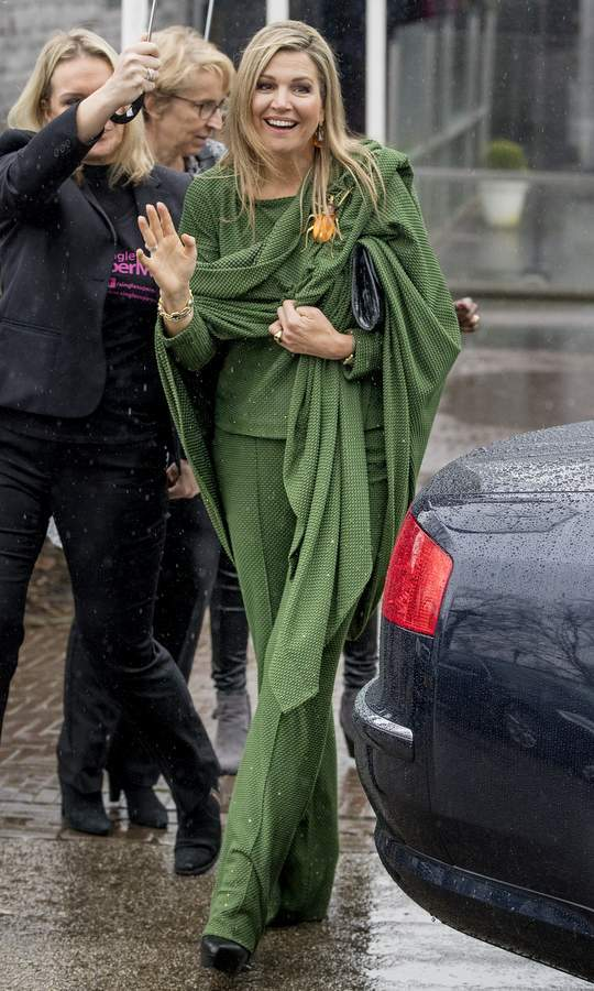 Queen Maxima of the Netherlands attended a Foundation Single Supermom meeting on International Women's Day in Amsterdam wearing this green color block ensemble. 