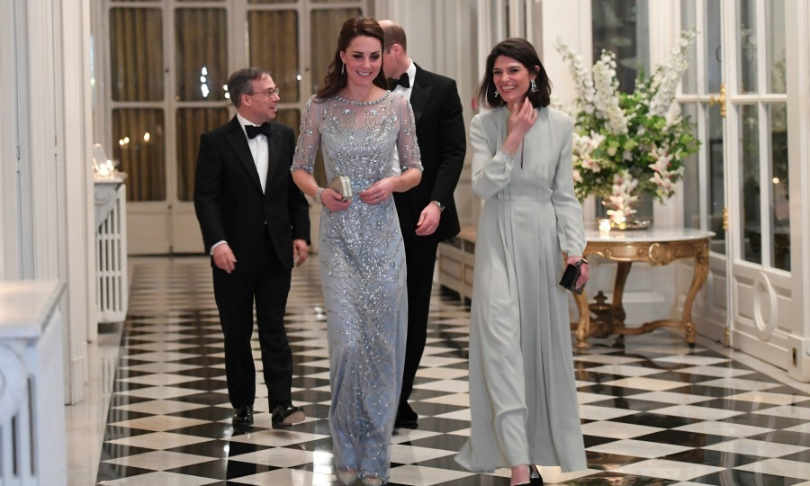 Kate sparkled in an icey-blue Jenny Packham gown as she headed in. The Duchess was glowing as she and her husband mingled with their fellow dinner guests.