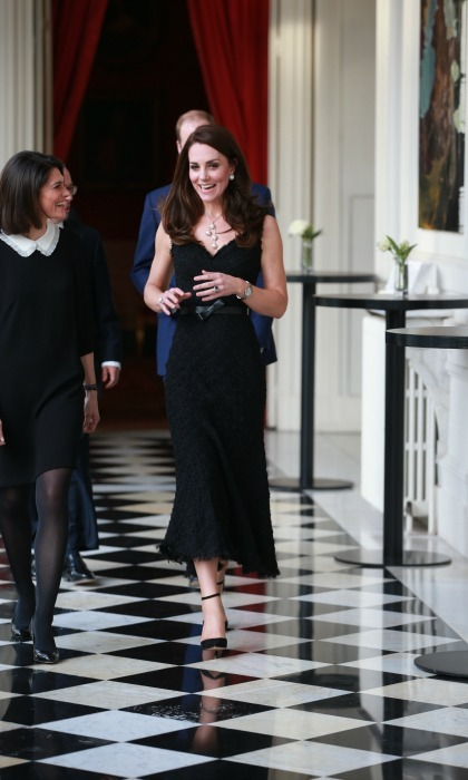 Quick change! Later on in the day, Kate stunned in a black tweed Alexander McQueen dress, as she and William arrived at a reception at the British Embassy ahead of the night's black tie gala dinner.