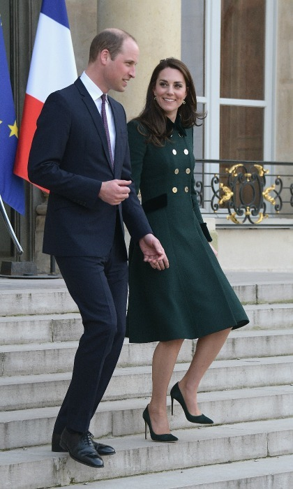 Kate looked sophisticated in a chic dark green coat from one of her favorite designers, Catherine Walker, giving a clear nod to St. Patrick's Day. She also wore her trademark bouncy curls, while William looked dapper in a navy suit. 
