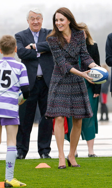 Kate then proved the look to be versatile, when she got sporty with a group of local children! Still clad in Chanel, the royal showed off her rugby skills.