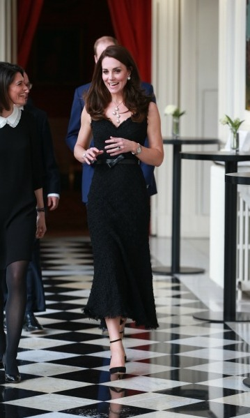 Kate then slipped into an Alexander McQueen black tweed dress for a special gathering at the British Embassy in Paris. She paired the look with ankle strap pumps and some gorgeous pearls, dripping with sophistication.