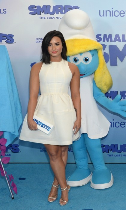 "March 18: Demi Lovato looked elegant in white on the blue carpet at the United Nations Headquarters in NYC. <i>The Smurfs: Lost Village</i> star joined her co-stars to celebrate ""International Day of Happiness"" and the film. Demi wore a Jill Stuart dress, Giuseppe Zanotti heels and carried an Edie Parker handbag.