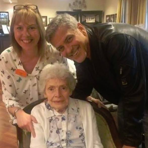 "March 19: George Clooney made this fan's day by surprising her on her 87th birthday. The dad-to-be stopped by the Sunrise of Sonning senior living facility which is near his England home to wish Pat Adams a happy day. A staffer wrote on the facility's Facebook page: ""The lady in the picture, loves George Clooney and mentions every day how she would love to meet him, especially as he lives so near to where I work. So letters have been sent asking would it be possible for her dream to come true.""