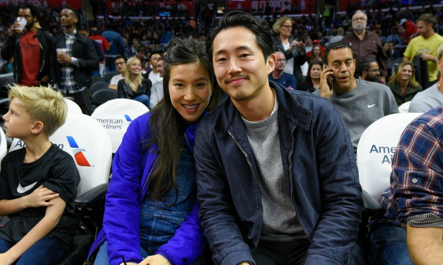 <i>Walking Dead</i> star Steven Yeun and his wife Joana Pak welcomed the third member of their family! The star's rep confirmed to E! News that the pair welcomed a son on March 17.
