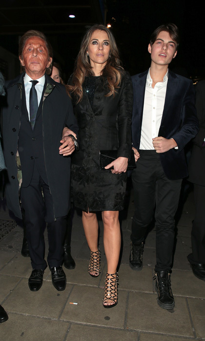 March 22: Elizabeth Hurley had two dapper dates for the London opening night of <i>An American in Paris</i>. The <i>Royals</i> star stepped out with her dashing 14-year-old son Damian and designer Valentino Garavani.