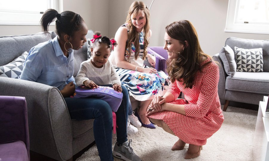 Catherine, Duchess of Cambridge had a chat with Kirsty Francois, left, and her two-year-old daughter Teegan-Mia during a parent support group meeting on March 23 at the Best Beginnings charity in London.