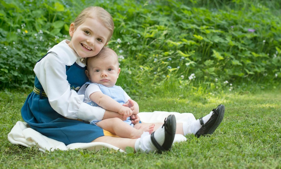 Proud big sister Princess Estelle cradled her brother Prince Oscar in a 2016 photo released in honor of Sweden's National Day.