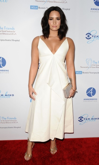 March 22: Demi Lovato glowed on the red carpet at UCLA's Semel Institute's biannual 'Open Mind Gala' at the Beverly Hilton Hotel in California. Her ethereal look was topped off striking gold heels.