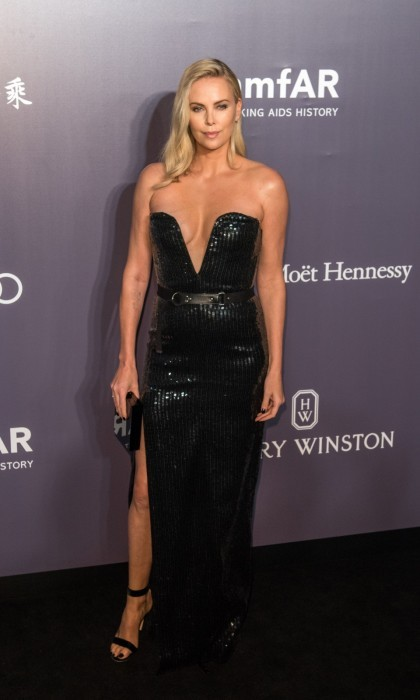 March 25: Charlize Theron shimmered in a plunging black Yves Saint Laurent gown on the carpet during the 2017 American Foundation for AIDS Research (amfAR) third annual Hong Kong gala at Shaw Studios. The star offered an exclusive opportunity during the event's live auction for two people to attend the New York City premiere of <i>The Fate of the Furious</i>, the eighth film in the epic <i>Fast and the Furious</i> franchise, along with tickets to the VIP after-party and a suite at The Peninsula New York. Her prize sold twice for a total of $200,000 adding to the night's whopping $3.5 million raised.